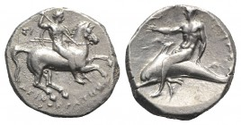 Southern Apulia, Tarentum, c. 302-280 BC. AR Nomos (21mm, 7.08g, 12h). Warrior on horseback r., holding shield and two spears, preparing to cast a thi...