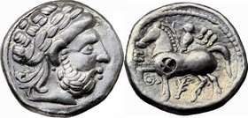 Celtic World. Celtic, Eastern Europe. AR Tetradrachm, imitation of Philip II of Macedon, 3rd century BC. D/ Laureate head of Zeus with crude features ...