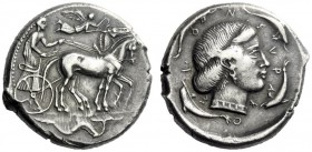 The M.L. Collection of Coins of Magna Graecia and Sicily   Syracuse  Tetradrachm circa 450, AR 17.37 g. Slow quadriga driven r. by bearded charioteer...