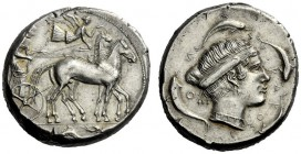 The M.L. Collection of Coins of Magna Graecia and Sicily   Syracuse  Tetradrachm circa 450-440, AR 17.36 g. Slow quadriga driven r. by bearded chario...