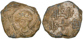 UNCERTAIN ISSUER Lead personal seal Obverse: Nimbate bust facing, bare-headed and holding sceptre Reverse: Cross pattée dividing middle word of three-...