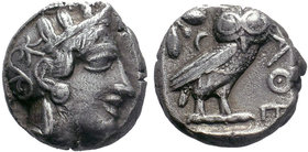 Attica, Athens AR Tetradrachm. Circa 454-404 BC. Head of Athena right, wearing crested Attic helmet ornamented with three olive leaves above visor and...