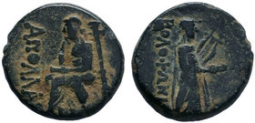 Ionia. Kolophon circa 100-0 BC. ΠΥΘΕΟΣ , magistrate, AE Bronze, Homer sitting left on chair with high backrest, holding book in left hand, supporting ...