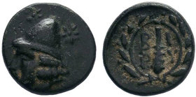 Troas, Birytis. civic issue. 4th-3rd centuries B.C. AE 20 Bronze. Beardless head of Kabeiros left, wearing pilos; stars flanking pilos / B - I / P - Y...