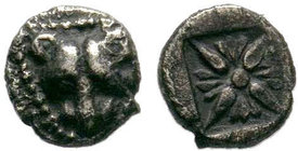 Ionia, Miletos, late 6th-early 5th century BC. AR Obol. Panther or lion head facing. R/ Stellate floral pattern within incuse square. Klein 421-2; SNG...