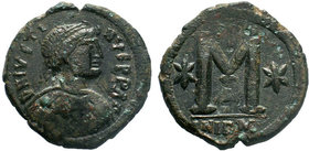 BYZANTINE.Justinian I. AE Follis, Nicomedia. DN IVSTINIANVS PP AVG, pearl diademed, draped, cuirassed bust right / Large M, star to left, cross above,...