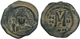 BYZANTINE.Maurice Tiberius, 582-602 AD, AE Follis. Constantinople. DN TIbER mAVRC PP AVI or DN mAVRIC TIBER PP AVI, crowned, cuirassed bust facing, ho...