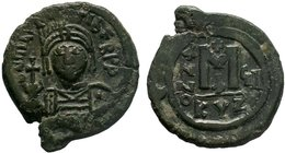 BYZANTINE.Maurice Tiberius, 582-602 AD, AE Follis, Cyzicus. DN TIBER MAVRIC PP A, helmeted and cuirassed or crowned and cuirassed bust facing, holding...