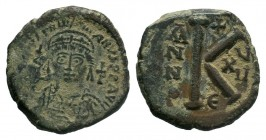 BYZANTINE.Justin I AE Half Follis. 565-578 AD. Constantinopol mint. D N IVSTINVS P P AVG, Justin at left, Sophia at right, seated facing on double-thr...