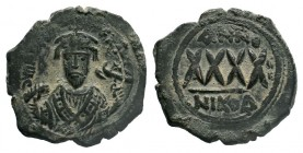 BYZANTINE.Phocas. 602-610 AD. AE Follis. Constantinople. DM FOCAE PP AVG, crowned, mantled bust facing, holding mappa and cross / Large XXXX, ANNO abo...