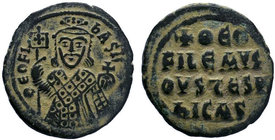 BYZANTINE.Theophilus AE Follis. 830-842 AD. Constantinople. ThEOFIL' bASIL' CL, crowned, three-quarter length figure of Theophilus facing, pellets on ...