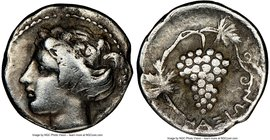 SICILY. Naxos. Ca. 420-403 BC. AR litra (11mm, 0.92 gm, 4h). NGC VF 5/5 - 3/5. Head of young Dionysus left, wreathed in ivy, beaded border / NAΞIΩN, b...