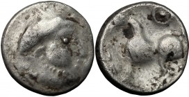 Celtic World. Celtic, Eastern Europe. AR Drachm type Kugelwange, 2nd-1st century BC. D/ Head right, laureate. R/ Horse left; above, circle with dot in...