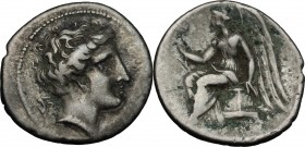 Greek Italy. Bruttium, Terina. AR Drachm, circa 300 BC. D/ Head of the nymph Terina right; triskeles behind neck. R/ Nike seated left on plinth, holdi...