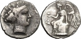 Greek Italy. Bruttium, Terina. AR Drachm, c. 300 BC. D/ Head of the nymph Terina right. R/ Nike seated left on cippus, holding bird on hand; to left, ...