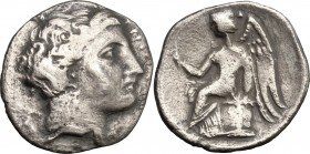 Greek Italy. Bruttium, Terina. AR Drachm, c. 300 BC. D/ Head of nymph Terina right. R/ Nike seated left on cippus, holding caduceus (?). HN Italy 2642...