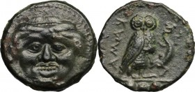Sicily. Kamarina. AE Tetras, 425-405 BC. D/ Gorgoneion. R/ Owl standing right, head facing, holding lizard; in exergue, three pellets. CNS III, 21. AE...
