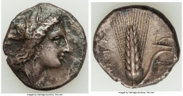 LUCANIA. Metapontum. Ca. 330-280 BC. AR stater (20mm, 7.47 gm, 9h). VF. Head of Demeter right, crowned with grain; ΔAI (off flan) before / META, grain...