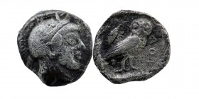 Attica, Athens. 449-404 B.C. AR obol  Helmeted head of Athena right Rev: AΘE, owl standing right within incuse, olive branch to left.  Kroll 13; SNG C...